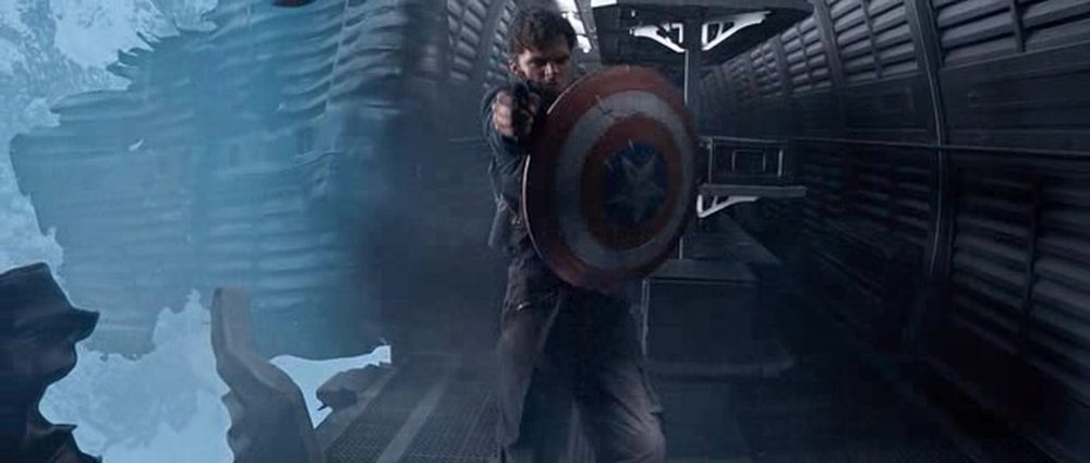 Bucky holds the shield....