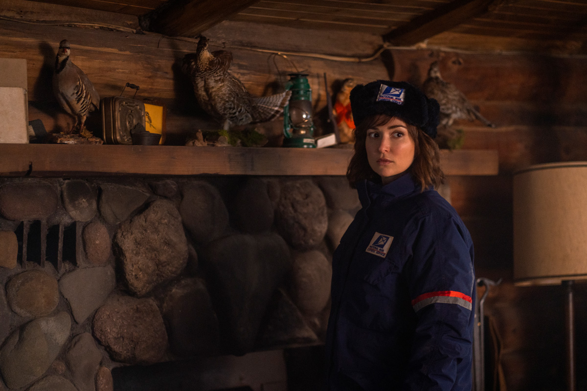 Milana Vayntrub in WEREWOLVES WITHIN, produced by Ubisoft Film & Television, Vanishing Angle, and Sam Richardson. IFC Films will release the film June 25th, 2021 in select theaters and on demand.